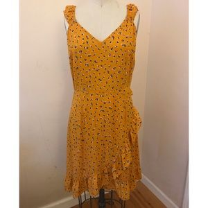 NWOT yellow floral dress with ruffle wrap detail